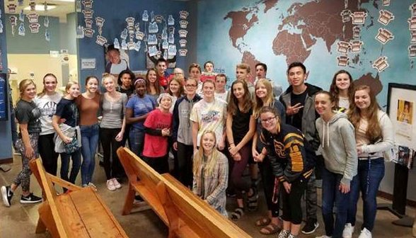 The Prior Lake Junior Optimist Club volunteering at Feed My Starving Children