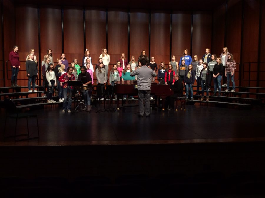 The+Choralaires+practice+on+stage+under+the+direction+of+choir+director+Mr.+Robert+Hahn.