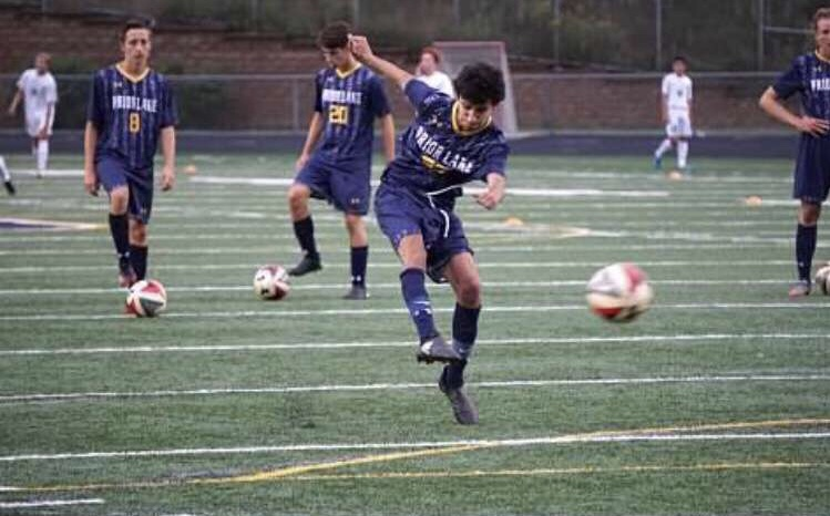 The+Prior+Lake+boys%27+varsity+soccer+team+warming+up+before+a+game.