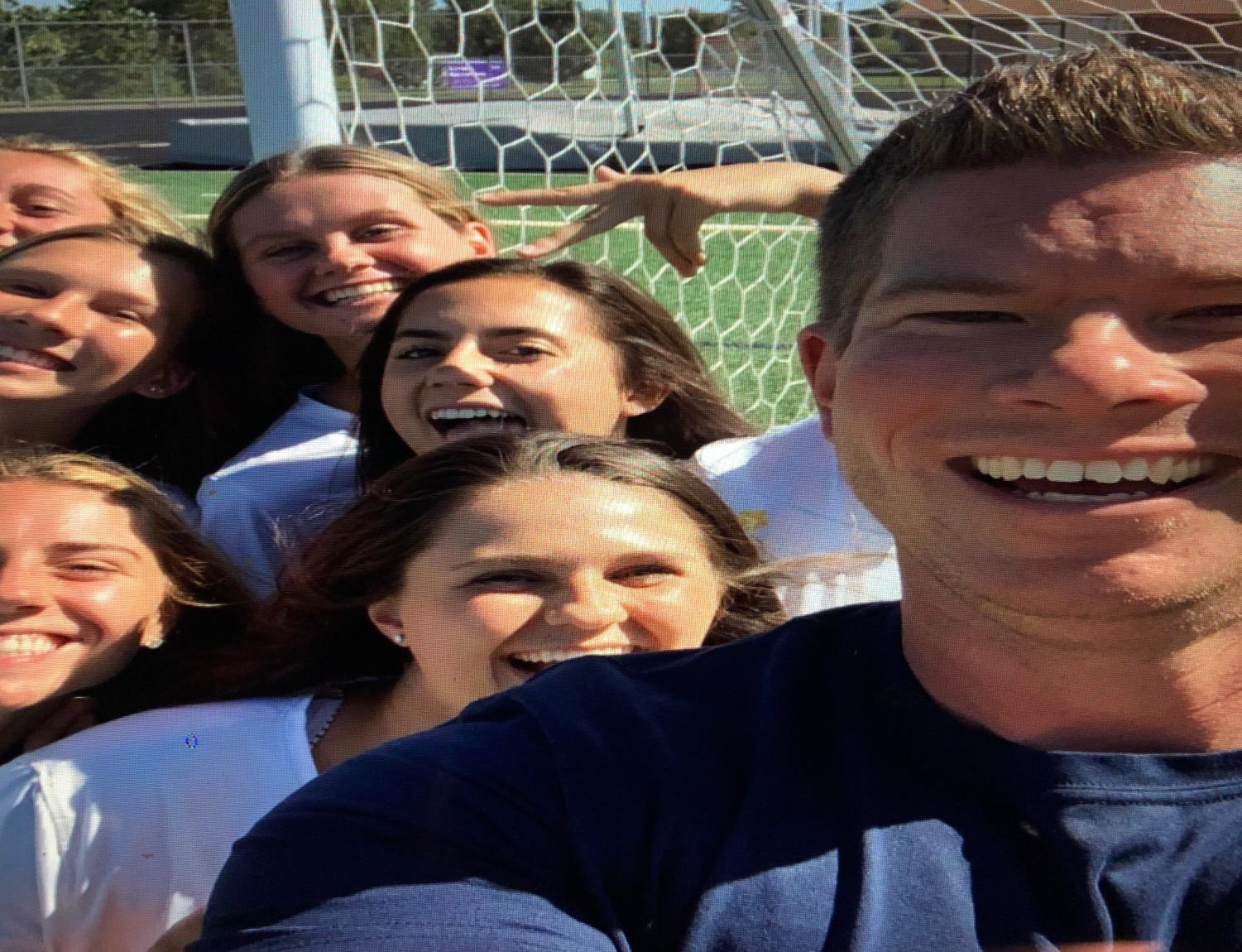Girls team bonding with coach Andy Lissick on picture day